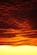 Deep red cloud layers with yellow sky
