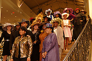 MC Sharon Howard (left, front) and the models gather on the stairs for a group photo after the CROWNS Hat Show at Books & Company in The Greene in Beavercreek, Saturday, February 26, 2011.