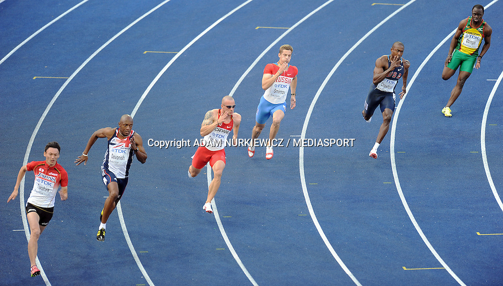 (L-R) SHINJI TAKAHIRA (JAPAN) & MARLON DEVONISH (GREAT BRITAIN) & JARED CONNAUGHTON (CANADA) & ROMAN SMIRNOV (RUSSIA) & SHAWN CROWFORD (USA) & DRIAN DZINGAI (ZIMBABWE) COMPETE IN 200 METERS MEN SECOND ROUND ON THE OLYMPIC STADION ( OLIMPIASTADION ) DURING 12TH IAAF WORLD CHAMPIONSHIPS IN ATHLETICS BERLIN 2009..BERLIN , GERMANY , AUGUST 18, 2009..( PHOTO BY ADAM NURKIEWICZ / MEDIASPORT )..PICTURE ALSO AVAIBLE IN RAW OR TIFF FORMAT ON SPECIAL REQUEST.