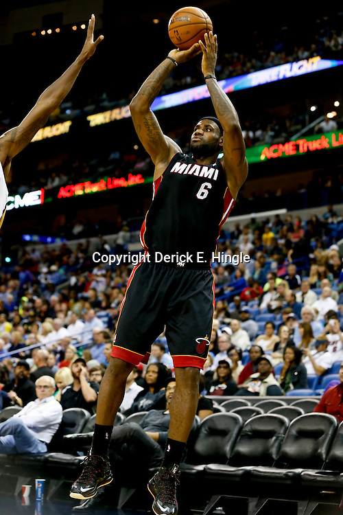 Oct 23, 2013; New Orleans, LA, USA; Miami Heat small forward LeBron James (6) shoots against the New Orleans Pelicans during the second half of a preseason game at New Orleans Arena. The Heat defeated the Pelicans 108-95. Mandatory Credit: Derick E. Hingle-USA TODAY Sports