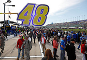 Fans mingle with drivers along Pit Road before the start of a NASCAR Cup Series auto race at Kansas Speedway in Kansas City, Kan., Sunday, Oct. 22, 2017. (AP Photo/Colin E. Braley)