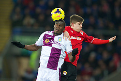 CARDIFF, WALES - Tuesday, February 11, 2014: Aston Villa's Christian Benteke in action against Cardiff City's Declan John during the Premiership match at the Cardiff City Stadium. (Pic by David Rawcliffe/Propaganda)