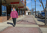 Deb Turnball walks along Bremer Avenue in downtown Waverly, Iowa on Thursday March 19, 2009.