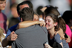 A family reunites outside of Stoneman Douglas High School in Parkland, FL, USA, after a shooting on Wednesday, February 14, 2018. Photo by John McCall/Sun Sentinel/TNS/ABACAPRESS.COM