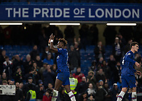 Football - 2019 / 2020 Premier League - Chelsea vs. Burnley<br /> <br /> Tammy Abraham (Chelsea FC) applauds the fans under the Pride of London sign at Stamford Bridge <br /> <br /> COLORSPORT/DANIEL BEARHAM