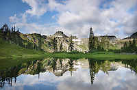Table Mountain reflected in small lake in Heather Meadows Recreation Area, North Cascades Washington