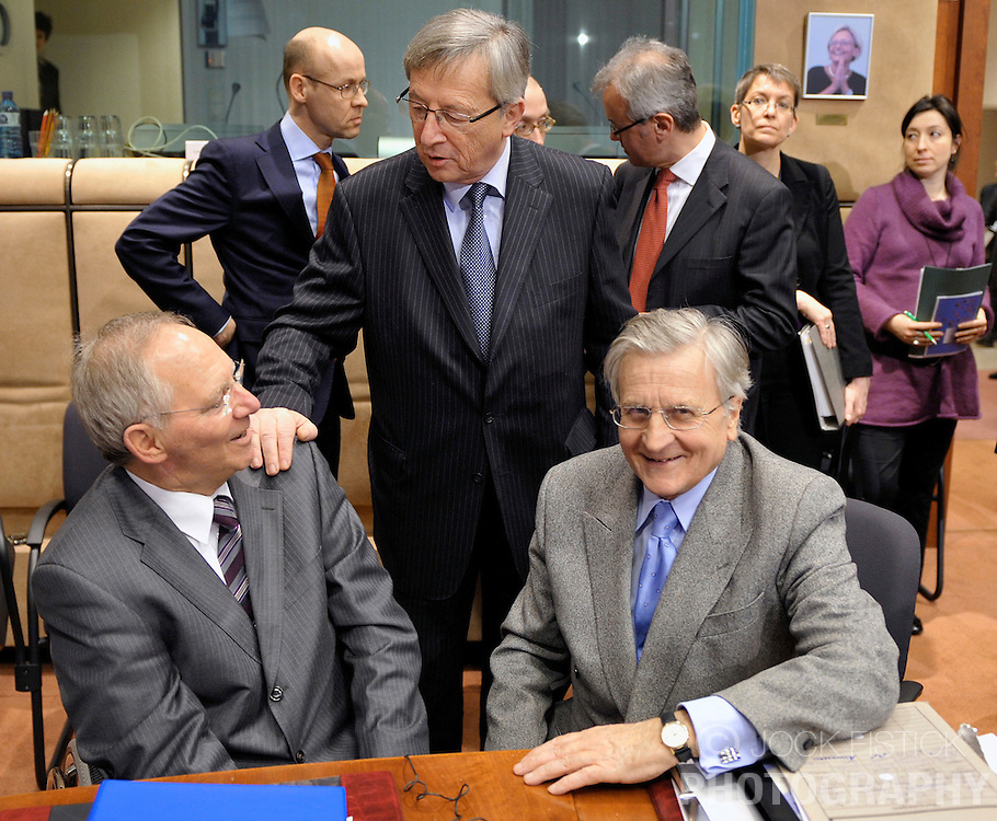 Jean-Claude Juncker, Luxembourg's prime minister, and president of the Eurogroup, center, greets Wolfgang Schaeuble, Germany's finance minister, left, and Jean-Claude Trichet, president of the European Central Bank, right, during the Eurogroup meeting in Brussels, Belgium, on Monday, Feb. 15, 2009. (Photo © Jock Fistick)