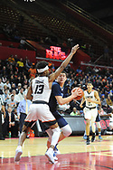 Shawnee's Dylan Deveney (44) attempts to drive to the basket as Linden's Tavon Jones (13) defends in the first quarter of the New Jersey Group 4 State Championship game Sunday March 12, 2017 at Rutgers University in Piscataway, New Jersey. (Photo by William Thomas Cain)