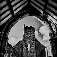 Church ruins with arch in foreground