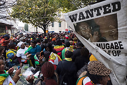 © Licensed to London News Pictures. 18/11/2017. London, UK. Hundreds gather outside the Zimbabwe embassy in London to protest against Robert Mugabe. Photo credit: Ray Tang/LNP