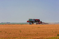 Tractor spraying fields, Schields & Sons Farm, near Goodland, Western Kansas USA.