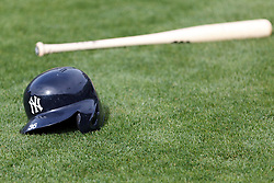 OAKLAND, CA - JUNE 14:  General view of a New York Yankees batting helmet and baseball bat on the field during batting practice before the game against the Oakland Athletics at O.co Coliseum on June 14, 2014 in Oakland, California. The Oakland Athletics defeated the New York Yankees 5-1.  (Photo by Jason O. Watson/Getty Images) *** Local Caption ***