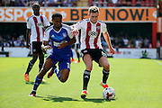 Ipswich midfielder Grant Ward (18) battles for the ball with Brentford defender Callum Elder (3) during the EFL Sky Bet Championship match between Brentford and Ipswich Town at Griffin Park, London, England on 13 August 2016. Photo by Matthew Redman.