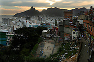 A soccer square in bad conditions and a slope with garbage are seen at the Cantagalo slum in Rio de Janeiro March 13, 2014.  Pilar Olivares (BRAZIL)