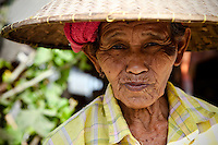Old face-lined and yet ageless Balinese woman.  Her look tells a story that no words can convey.