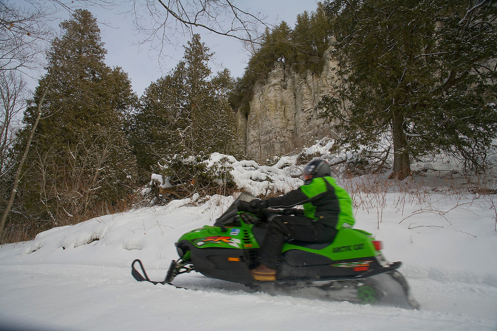 Snowmobiling in Penninsula State Park in Door County, Wisconsin.  (Photo by Mike Roemer)