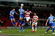 Ben Heneghan of Blackpool F.C. heads the ball clear during the EFL Sky Bet League 1 match between Doncaster Rovers and Blackpool at the Keepmoat Stadium, Doncaster, England on 17 September 2019.