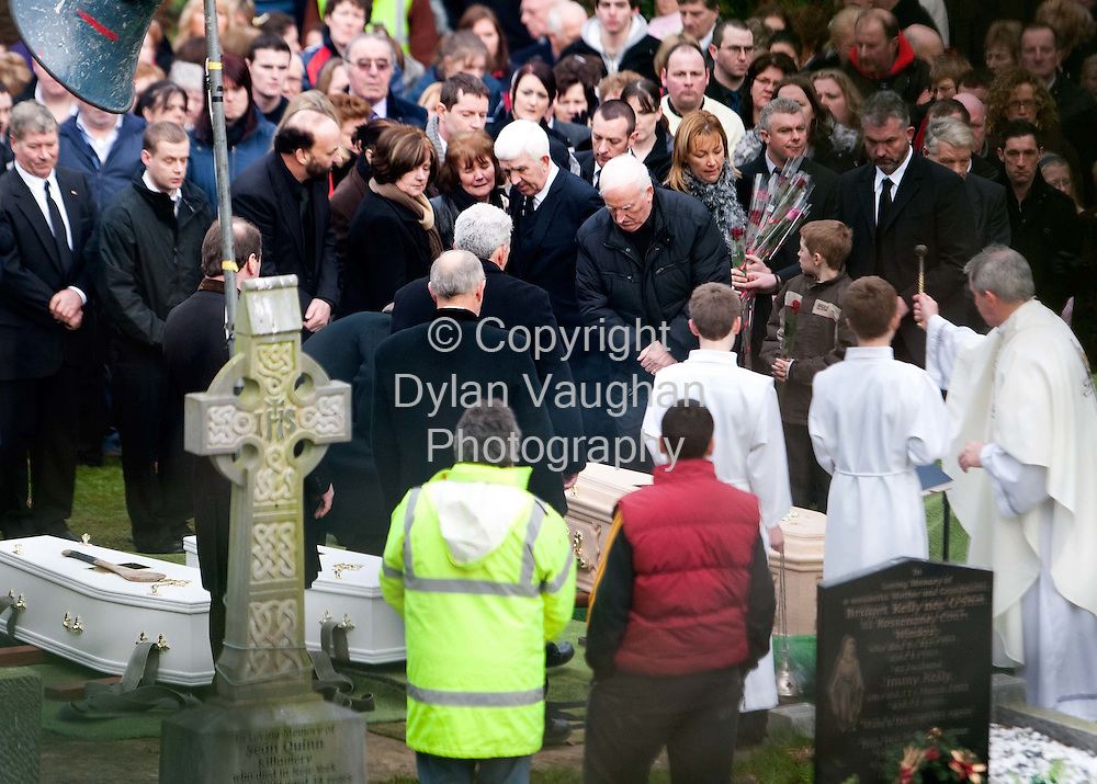 1/1/2009.Family and friends pictured at the Funeral of Sharon, Nadia (2) and Zsara (7) Whelan in Wingap county Kilkenny yesterday.Centre are Sharons parents Christy (white hair black suit black tie) and Nancy (left of (Christy).Picture Dylan Vaughan.