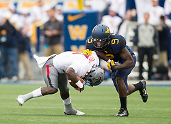 Nov 7, 2015; Morgantown, WV, USA; West Virginia Mountaineers safety KJ Dillon stops Texas Tech Red Raiders wide receiver Jakeem Grant in the backfield during the first quarter at Milan Puskar Stadium. Mandatory Credit: Ben Queen-USA TODAY Sports