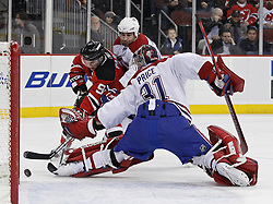 Dec 16, 2009; Newark, NJ, USA; Montreal Canadiens defenseman Roman Hamrlik (44) and Montreal Canadiens goalie Carey Price (31) defend on New Jersey Devils left wing Zach Parise (9) during the second period at the Prudential Center.