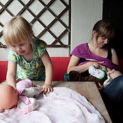 Oslo, Norway, August 25, 2012. Hanna, Norwegian, 36 years old, with her tho kids Anna, 3 years old, and Anton, 3 months old. Hannah is a teacher and has decided to share 57 weeks of parental leave with her partner Kai.
