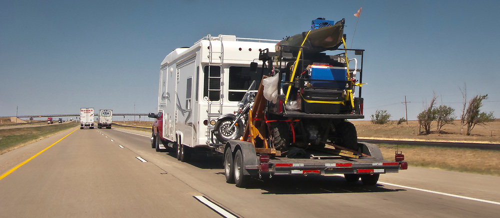 Pickup Truck Pulls Travel Trailer And Flatbed Trailer With