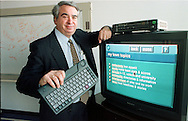 Hal Krisbergh, Chairman and CEO, of Worldgate, Inc., a cable television internet provider,  holds a cable tv keyboard in his right hand as he leans on a television in a conference room at Worldgate, Inc., Nov. 25, 1997 in Bensalem, Pa. He was displaying how their web service looks on the tv screen, and the keyboard he is holding is used to access the web, via cable tv.  On top of the television is the Worldgate cable internet box. (photo by William Thomas Cain) NEWSMAKERS WILLIAM THOMAS CAIN 12/10/98