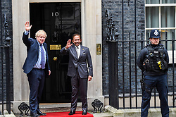 © Licensed to London News Pictures. 04/02/2020. LONDON, UK.  Hassanal Bolkiah, the Sultan of Brunei, (C) and Boris Johnson, Prime Minister, (L) wave to the media ahead of talks in Number 10 Downing Street.  Photo credit: Stephen Chung/LNP
