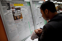 Roger Balcarcel holds his son Caleb Balcarcel, 1 month as he looks over job listings at the One Stop Career Link Center November 9, 2009 in San Francisco, California.  The national unemployment rate for October reached 10.2 percent, the highest level since 1983. Federal Reserve officials have warned that the unemployment rate will likely remain high for the next several years because the economic recovery won't be strong enough to spur robust hiring.  An estimated 16 million Americans are out of work.   (Photograph by David Paul Morris)