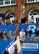 Jo-Wilfried Tsonga of France serves to Britain's Andy Murray, during their semifinal match for the Aegon Championships at the Queen's Club in London, Britain, 15 June 2013. EPA/BOGDAN MARAN