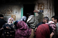 SYRIA - Al Qsair. People are queing in front of one of the three groceries in Al Qsair, on January 24, 2012. Al Qsair is a small town of 40000 inhabitants, located 25Km south-west of Homs. The town is besieged since the beginning of November and so far it counts 65 dead. ALESSIO ROMENZI