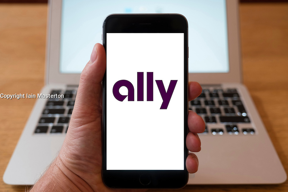 Using iPhone smartphone to display logo of Ally an American bank holding company