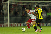 Sheffield United midfielder Louis Reed and Burton Albion forward Abdenasser El Khayati challenge for the ball during the Sky Bet League 1 match between Burton Albion and Sheffield Utd at the Pirelli Stadium, Burton upon Trent, England on 29 September 2015. Photo by Aaron Lupton.