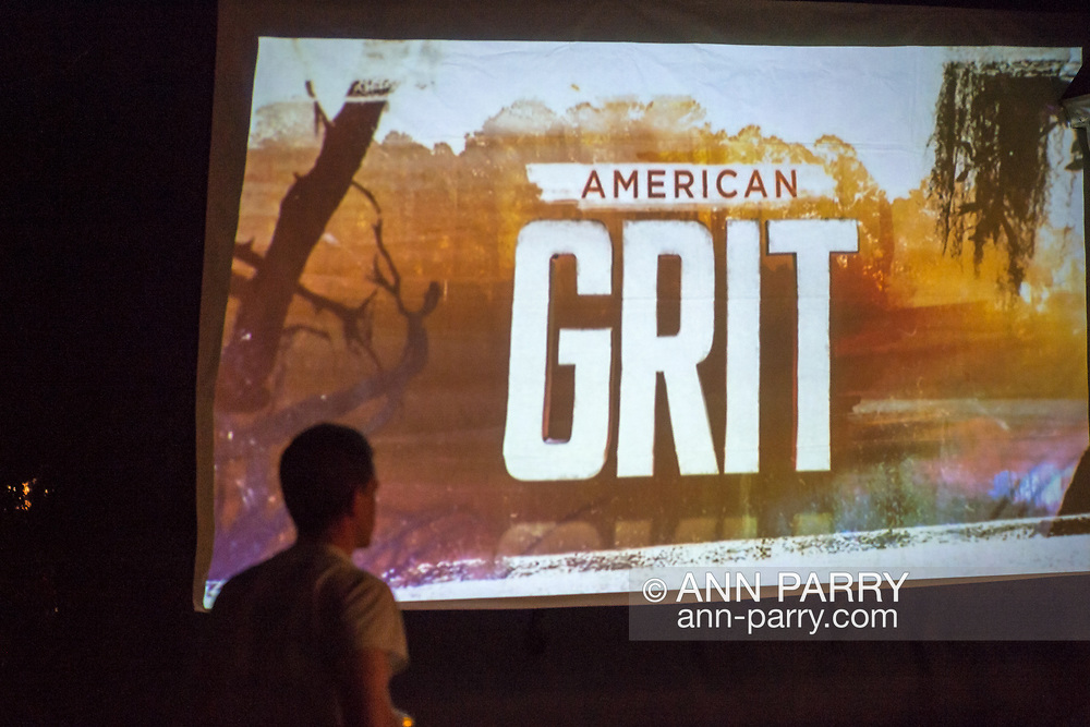 "Merrick, New York, USA. 11th June 2017.  In backyard of ""American Grit"" contestant Chris Edom, Edom walks up where the American Grit logo appears on large screen that show's premiere episode is projected on in his backyard. Edom family hosted neighborhood Viewing Party during broadcast of Episode 1 of the FOX network reality television series."
