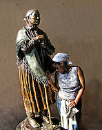 Indian statue and coloured girl