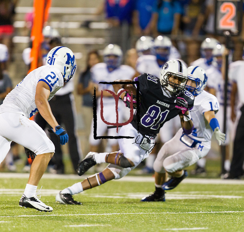 Cedar Ridge running back Raymond Racine in play action against MacArthur Friday night at Kelly Reeves Athletic Complex.