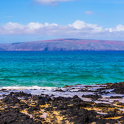 Secret Cove Paako Beach is a popular beach in Kihei Maui Hawaii. In the background is Kaho'olawe Island Reserve along Ahihi Bay in the Pacific Ocean. Panoramic photo ratio is 1:3. Copyright ⓒ 2019 Paul Velgos with All Rights Reserved.
