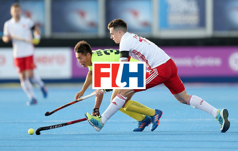 LONDON, ENGLAND - JUNE 15:  Zixiang Gou of China and Phil Roper of England battle for the ball during the Hero Hockey World League Semi Final match between India and Scotland at Lee Valley Hockey and Tennis Centre on June 15, 2017 in London, England.  (Photo by Alex Morton/Getty Images)