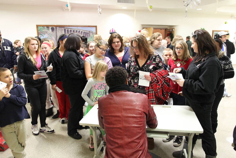 Actor and musician Trevor Jackson signs autographs for people at Manuel High School Tuesday December 18, 2012. Jackson attended the Concord Community Center as a younger child and was back visiting his home town. .Chris Bergin/ for The Star