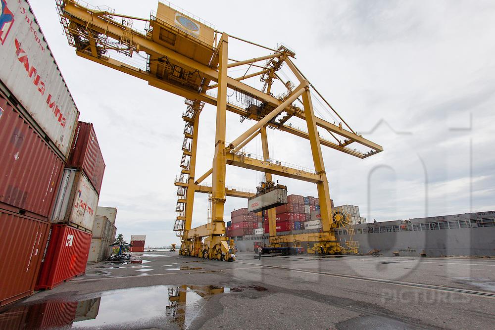 Gantry crane unloads containers in Danang harbour, Vietnam, Asia