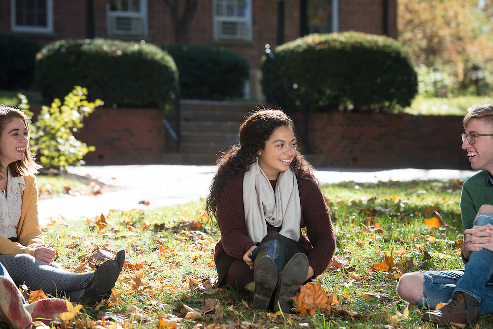 Selena Walsh, center, meets with friends Dottie Kramer, left, and Reid Troxel, right, on College Green on October 19, 2016.