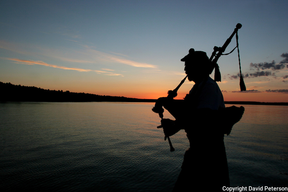 Every Friday evening during the summer months a bagpiper plays until the sun sets near Red Bay Ontario, Canada.  The weekly event draws locals and tourists to the dock where the traditional Irish music fills the warm summer air.