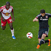 Nov 8, 2015; Harrison, NJ, USA; D.C. United defender Steve Birnbaum (15)passes the ball while being per-sued by New York Red Bulls forward Bradley Wright-Phillips (99) during the second half of the MLS Playoffs at Red Bull Arena. Mandatory Credit: William Hauser-USA TODAY Sports