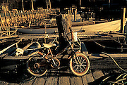 Image of bike and boats at the local marina in Rockport, Maine, American Northeast