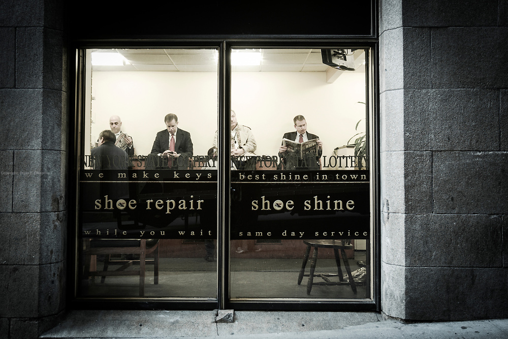 Men waiting to have their shoes shined and buffed at the Stanley Shoe Repair. According to people in the know, the Stanley delivers the best shoe shine of all the cobblers in the financial district.