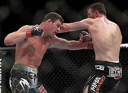 May 29, 2010; Las Vegas, NV; USA;  Michael Bisping (green/white trunks) and Dan Miller (black trunks) fight during their bout at UFC 114 at the MGM Grand Garden Arena in Las Vegas.