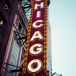 Photo of Chicago Theatre marquee sign with a vintage tone treatment. The Chicago Theatre was built in 1921 on State Street in downtown Chicago. The theater is a very popular Chicago attraction and now serves as a venue for concerts, plays, and other live performances.