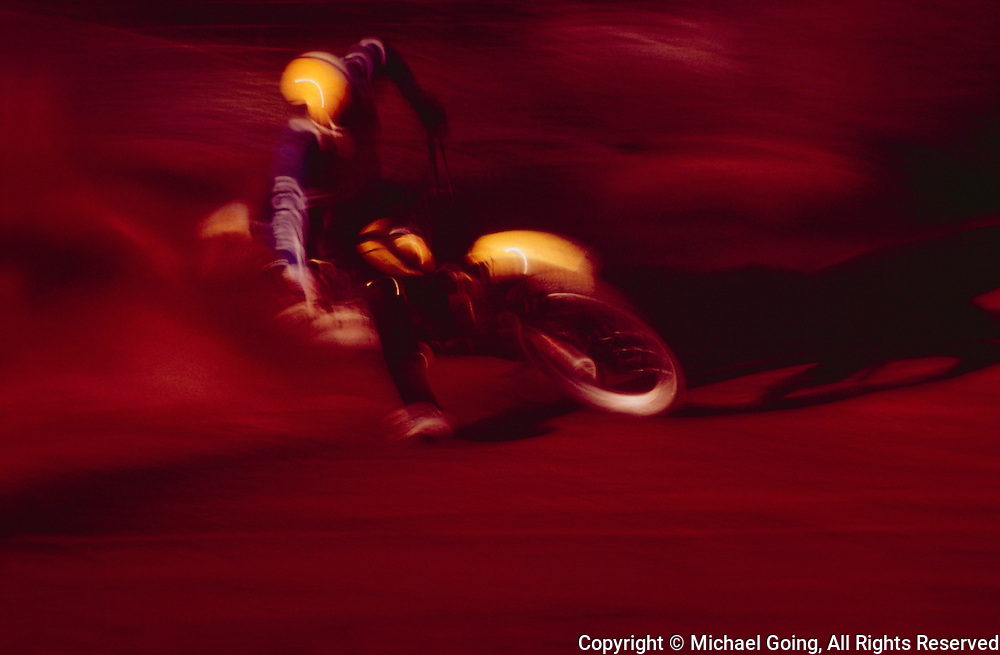 yellow dirt motorcycle with rider blurred action