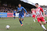 Lyle Taylor of AFC Wimbledon chases down the ball with Matty Pearson of Accrington Stanley FC the ball during the Sky Bet League 2 match between AFC Wimbledon and Accrington Stanley at the Cherry Red Records Stadium, Kingston, England on 5 March 2016. Photo by Stuart Butcher.
