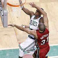 07 June 2012: Boston Celtics point guard Rajon Rondo (9) goes for the layup past Miami Heat small forward Shane Battier (31) during first half of Game 6 of the Eastern Conference Finals playoff series, Heat at Celtics at the TD Banknorth Garden, Boston, Massachusetts, USA.